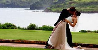 Lifestyle - Newlywed couple kiss in Hawaii, destination wedding